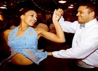 latin couple salsa dancing